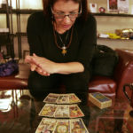 tarot reader looking at tarot cards