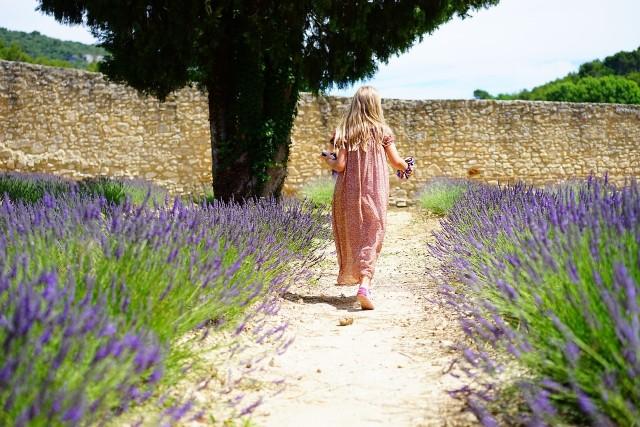 lady walking in crystal herbal garden